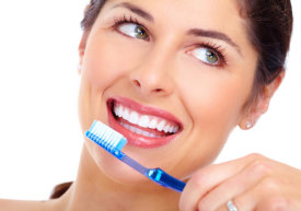 smiling beautiful woman holding a toothbrush